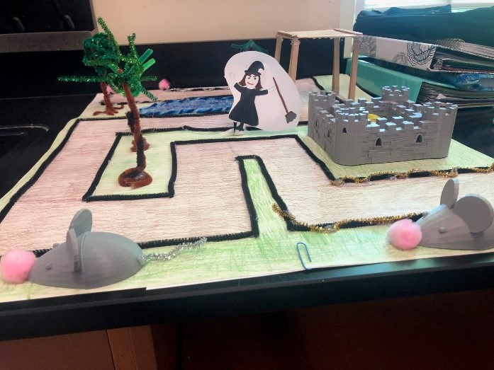 Photo of a completed course with 3-D printed mice and castle.