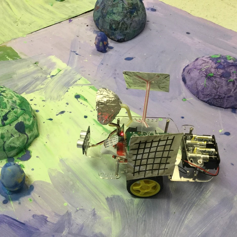 photo of student-created rovers exploring terrain