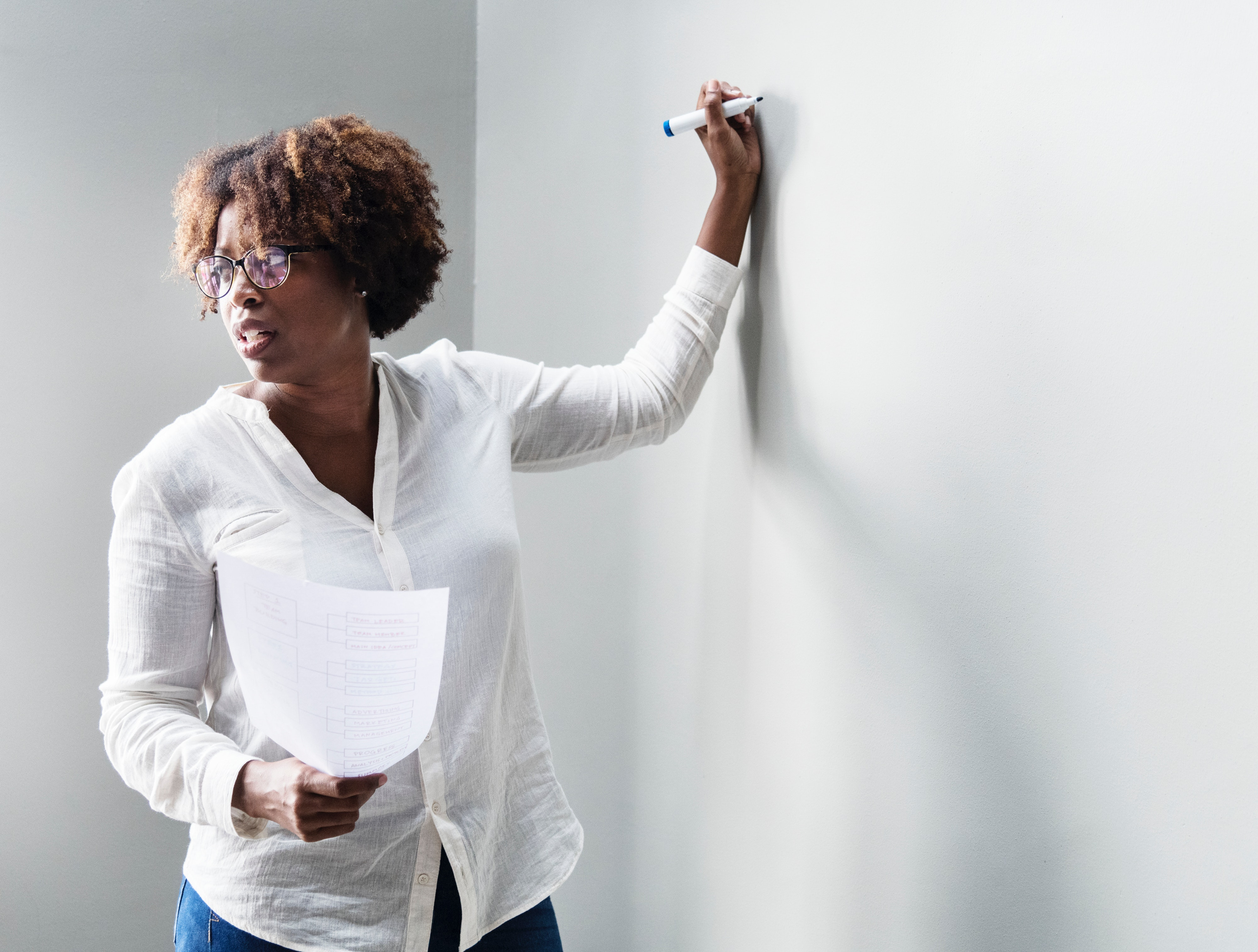 Picture of teacher standing at whiteboard